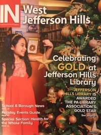 Cover iN COMMUNITY MAGAZINE - Child putting ornament on Library Christmas tree